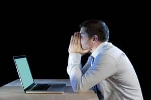 frustrated businessman working with computer laptop in stress